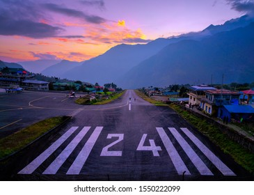 LUKLA/NEPAL, October 22 2019 Lukla airport. In the frame of the airport runway and taking off the plane. Nepal. Everest trekking