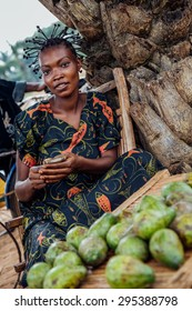 LUKONGA, DEMOCRATIC REPUBLIC OF CONGO - CIRCA, SEPTEMBER 2008. UNICEF mission against tetanus. Young african girl selling mango on the street.