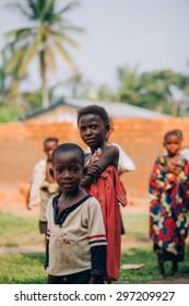 LUKONGA, DEMOCRATIC REPUBLIC OF CONGO - CIRCA SEPTEMBER 2008. UNICEF mission against tetanus. Village children near their house