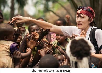 LUKONGA, DEMOCRATIC REPUBLIC OF CONGO - CIRCA, SEPTEMBER 2008.  UNICEF mission against tetanus. Volunteer works with Congolese children.