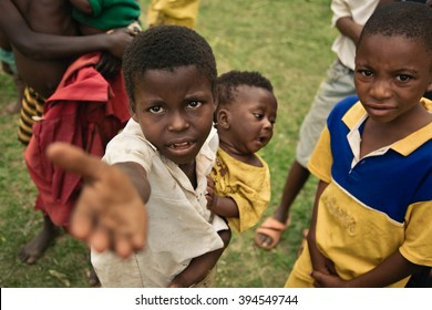 LUKONGA, DEMOCRATIC REPUBLIC OF CONGO - CIRCA SEPTEMBER 2008. UNICEF mission against tetanus.  Children asking for money from mission members.