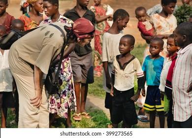 LUKONGA, DEMOCRATIC REPUBLIC OF CONGO - CIRCA, SEPTEMBER 2008. UNICEF mission against tetanus. Volunteer plays with Congolese children