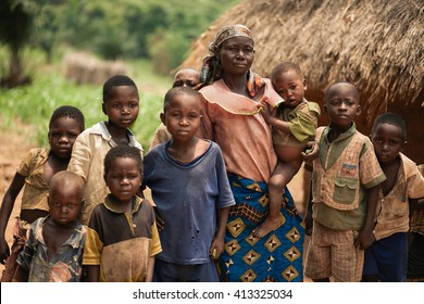 LUKONGA, DEMOCRATIC REPUBLIC OF CONGO - CIRCA, SEPTEMBER 2008. UNICEF mission against tetanus. Children and mother with little boys in their village.