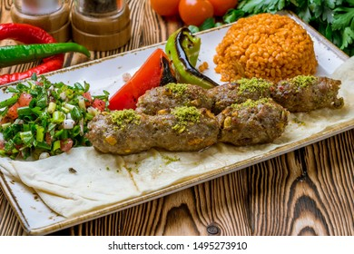 Lula kebab with pistachios Turkish cuisine on wooden table