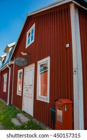 Lulea, Sweden - August 4, 2014: House at Gammelstad Lulea, Sweden. Sign with name of the house and postbox at the entrance.