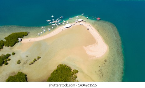 Luli island, Puerto Princesa, Palawan. Island hopping Tour at Honda Bay, Palawan. An island of white sand with mangroves. Atoll with a white island, view from above.