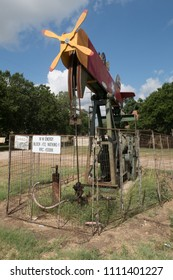 LULLING, TEXAS - JUNE 7 2018: a small pumpjack decorated to look like a plane being piloted by a dog