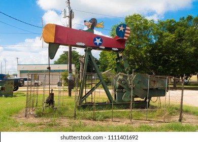 LULLING, TEXAS - JUNE 7 2018: a dog piloting a small oil pumpjack