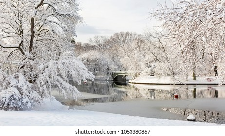 The Lullwater Bridge on Prospect Park Lake after a record Spring snowfall in Prospect Park, Brooklyn, New York.