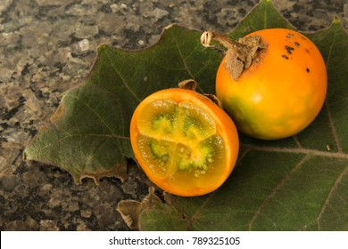 Lulo fruits placed on a lulo leaf. Delicious subtropical fruit from South America.