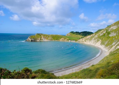 Lulworth Cove Bay Dorset with blue sky and sea