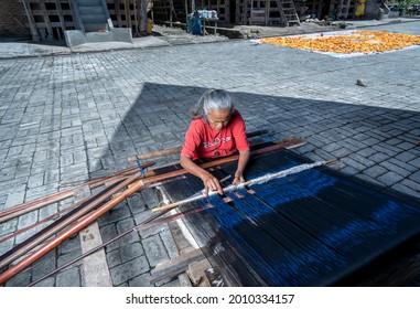 LUMBAN SUHI SUHI, SAMOSIR ISLAND, September 28, 2020 - Old women in this village make handicrafts, weave ulos. Ulos is one of the identities of the Batak people, especially on Samosir Island.