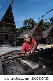 LUMBAN SUHI SUHI, SAMOSIR, September 28, 2020 - Old women in this village make handicrafts, weave ulos. Ulos is one of the identities of the Batak people, especially on Samosir Island.