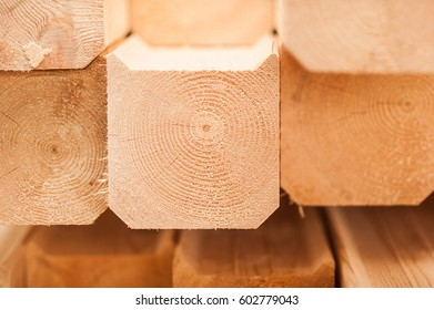 lumber industrial wood texture, timber butts background. Butt end of a processed wooden beam. many elements