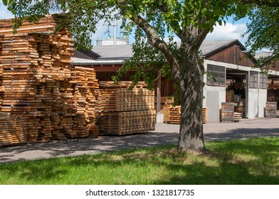 Lumber mill with stack of boards