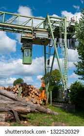 Lumber yard, tree trunks and rail crane