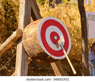 Lumberjack Axe throwing competition with axe stuck in target