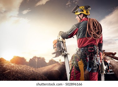 lumberjack with chainsaw isolated over black background