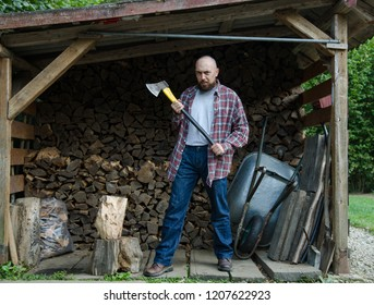 Lumberjack preparing firewood in the wood shed