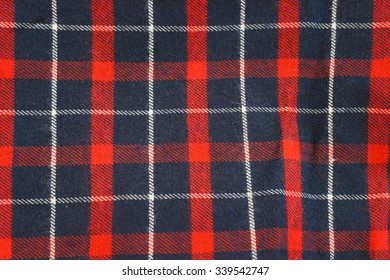 Lumberjack Tartan and Buffalo Check Plaid Patterns in Red, Dark Navy Blue, and White. Trendy Hipster Style Backgrounds.