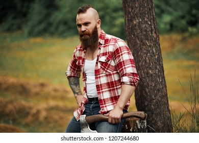 lumberjack worker standing forest axe chainsaw stock photo edit now