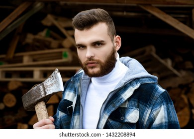 Lumbersexual concept. Bearded lumberjack checkered clothes carry axe. Sharp blade. Brutal man collects firewood. Hipster lifestyle. Masculinity and brutality. Lumberjack style. Stylish guy lumberjack.