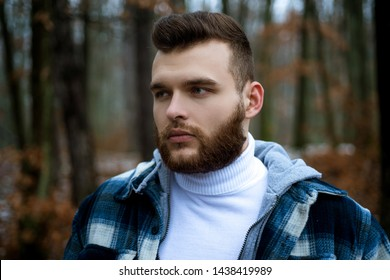 Lumbersexual concept. Bearded lumberjack checkered clothes. Brutal man walk in forest. Hipster lifestyle. Masculinity and brutality. Lumberjack style. Stylish guy lumberjack. Well groomed hipster.