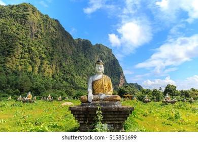 Lumbini garden 2000 buddha statues in green field at the bottom of Mount Zwegabin , Hpa An , Myanamr