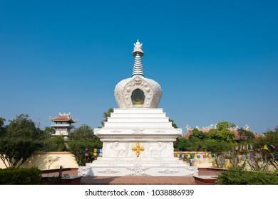 Lumbini, Nepal - Dec 09 2017: Stupa at Geden International Monastery (Austria Temple) in Lumbini, Nepal. Lumbini, the Birthplace of the Lord Buddha and The Eight Great Places.