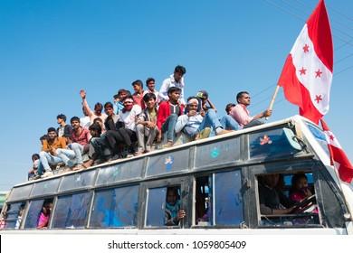 Lumbini, Nepal - Dec 10 2017: Supporters of Nepali Congress on a bus in Lumbini, Nepal. Lumbini, They go to the election campaign.