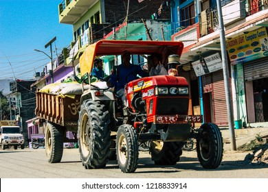 Lumbini Nepal November 1, 2018 View of a tractor in the main street of the old Lumbini in the afternoon
