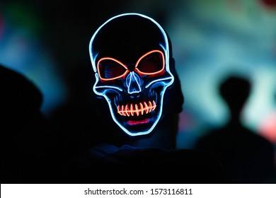 Luminating Light-up skull mask shot at a local night event