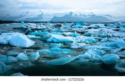 Luminous blue icebergs floating in Jokulsarlon glacial lagoon, Iceland