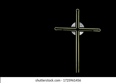 Luminous cross of a church in front of the supermoon at night