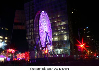 Luminous Ferris wheel during Montreal vivid Festival of Lights. Colorful illuminated silhouettes in the night. Winter festival of arts. Outdoor family activities. Entertainment District.