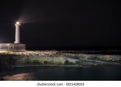 Luminous lighthouse Santa Croce near Augusta in Sicily at night