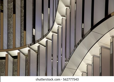 Luminous metal panels. Close-up photo of building exterior fragment. Abstract image on the subject of modern architecture. Engineering or technology motif.