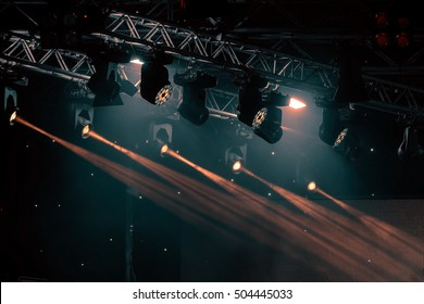 luminous rays from concert lighting against a dark background, musical instrument concept