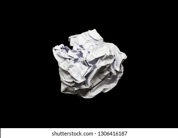 Lump Crumpled paper ball isolated on a black background. Lump Crumpled paper for the texture. Crumbled paper wad after brainstorming,thrown into the trash. Lump of Creased paper on a black background.