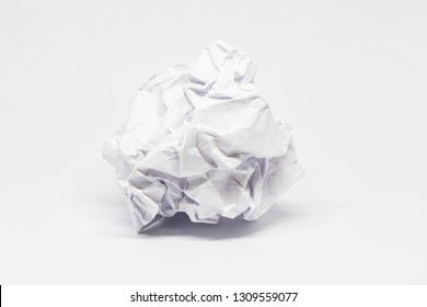 Lump Crumpled paper ball isolated on a white background. Lump Crumpled paper for the texture. Crumbled paper wad after brainstorming,thrown into the trash. Lump of Creased paper on a white background.
