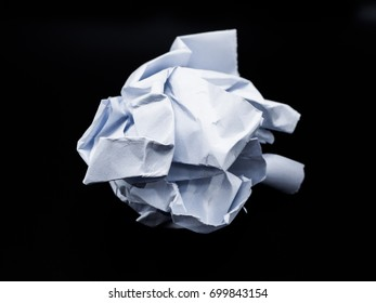 lump paper isolated on black background