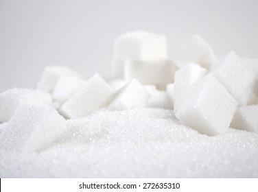 Lump sugar on white background