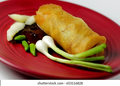 Lumpia, typical food from Semarang city, served on a red plate