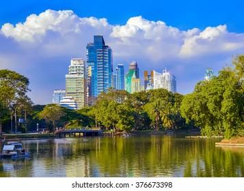 Lumpini Park, lake, modern apartments in downtown Bangkok, Thailand