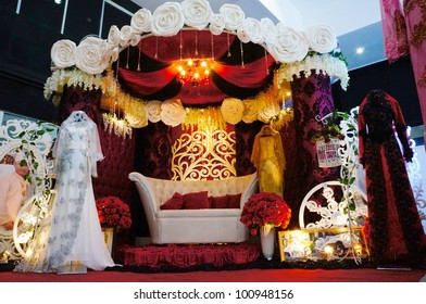 LUMUT, MALAYSIA - APR 22: A decoration of bridal throne and dresses from Sam Collection during Perak Bridal Carnival at Marina Island Hall on Apr 22, 2012 in Lumut Perak, Malaysia.