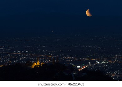 Lunar eclipse over Chiang mai city in Thailand.