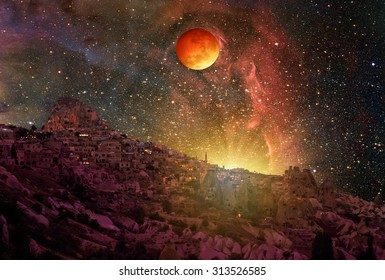 "Lunar eclipse and Super Moon against Cappadocia at night ""Elements of this image furnished by NASA """