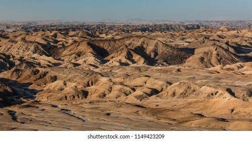 Lunar Landscape, outside of Swakopmund, in the Namib-Naukluft National Park with dried up river bed, moon like landscape. Global warming concept, dried out earth