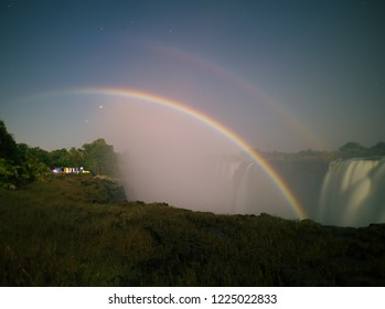 A lunar rainbow or a moonbow on the Victoria Falls observed within 2 days of full moon. Since the lunar rainbows are much fainter than the day-time ones, long-time exposure is mandatory.