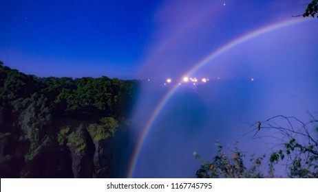 A lunar rainbow(Moonbow) at night, Victoria Falls, Zambia, Africa